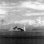 U.S. Navy Task Force 38 aircraft attack the Imperial Japanese Navy battleship Musashi (foreground) and a destroyer in the Sibuyan Sea, 24 October 1944.