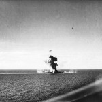 kumano cruiserunder aerial attack at leyte.