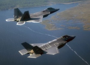 An F-22A Raptor (top) from the 43rd Fighter Squadron at Tyndall Air Force Base, Fla., and an F-35A Lightning II joint strike fighter from the 33rd Fighter Wing at Eglin Air Force Base, Fla., fly over the Emerald coast