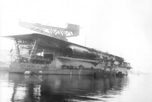 Kaga‍ '​s fitting-out in 1928. This stern view shows the long funnel extending aft below the flight deck, and three 8-inch (200 mm) guns in casemates