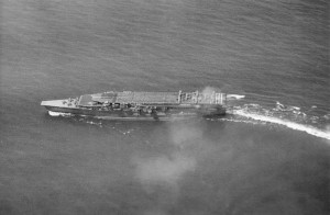 Kaga conducting air operations in 1930. On the upper deck are Mitsubishi B1M torpedo bombers preparing for takeoff. Nakajima A1N Type 3 fighters are parked on the lower deck forward.