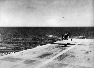 A Japanese B5N2 Kate taking off from the flight deck of the aircraft carrier Zuikaku for the attack on Pearl Harbor, at about 07:20h on 7 December 1941. Note the Aichi D3A1 Val in the background.