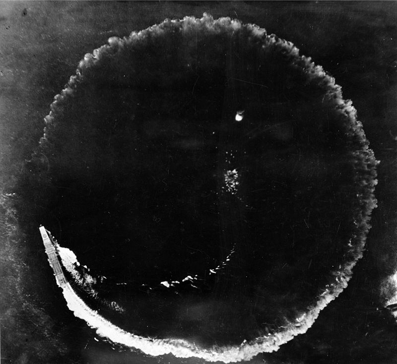 Aerial photograph of Sōryū and its circular wake on the morning of 4 June 1942. The ship was circling to evade bombs dropped from high altitude by US B-17 aircraft. The photograph was taken from one of the B17s.