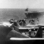 D3A dive bombers preparing to take off from an aircraft carrier for the attack on Pearl Harbor; Sōryū is in the background.