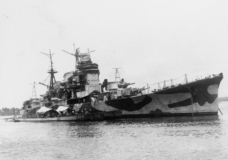 CAPTAIN POWER VISITS DAMAGED JAPANESE CRUISER. 25 SEPTEMBER 1945, SINGAPORE
