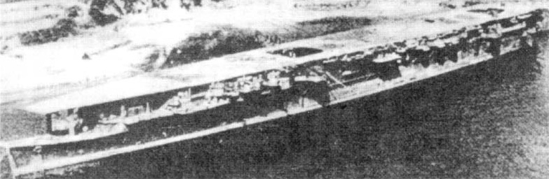 Light aircraft carrier Ryūhō photographed by US Navy aircraft at Kure in September 1945, showing damage to elevators.