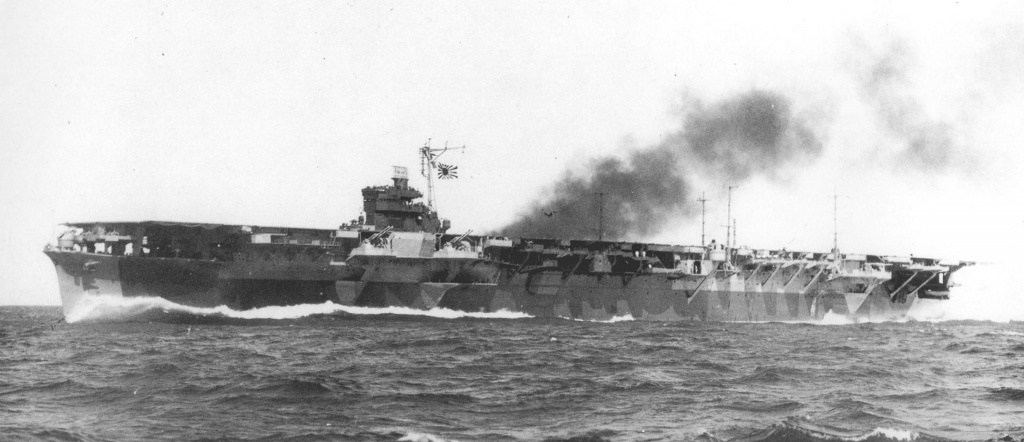 Katsuragi Japanese aircraft carrier in 1944. Note the exposed AA weapons.