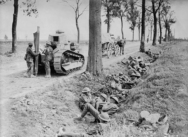 Canadian troops shelter in a ditch along the Arras-Cambrai road.
