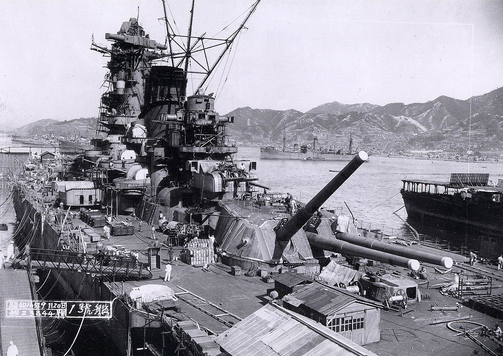 Japanese battleship Yamato under construction at the Kure Naval Base, Japan, September 20, 1941. The aircraft carrier Hosho is at the extreme right. The supply ship Mamiya is in the center distance.