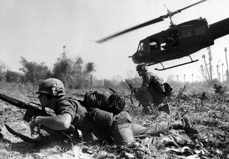 Combat operations at Ia Drang Valley, Vietnam, November 1965. Helicopter just discharged infrantry men to assault the Vietcong position.